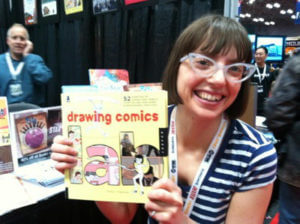 Robyn at a convention with her book Drawing Comcis