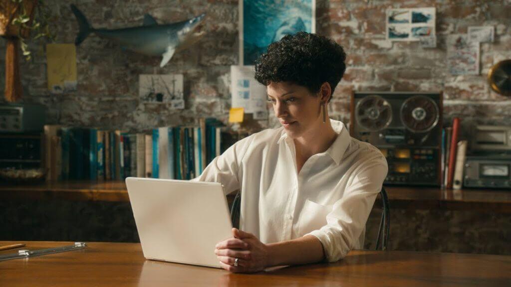 Katherine Roy working on a Windows 10 laptop